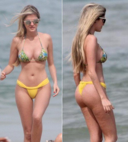 With her slim body and Regular blond hairtype without bra (cup size 34B) on the beach in bikini